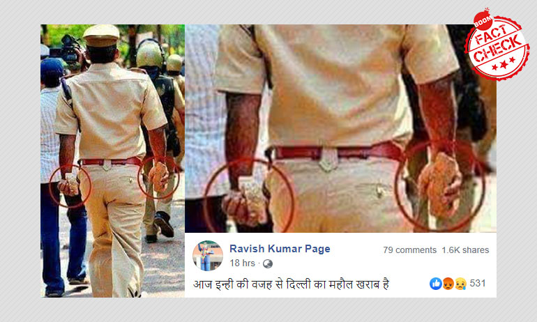Dated Picture Of Cop Holding Stones Spun As Police Violence In Delhi