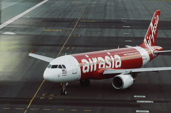 AirAsia aircraft model seen on track at Sepang Airport (Credit: Reuters)