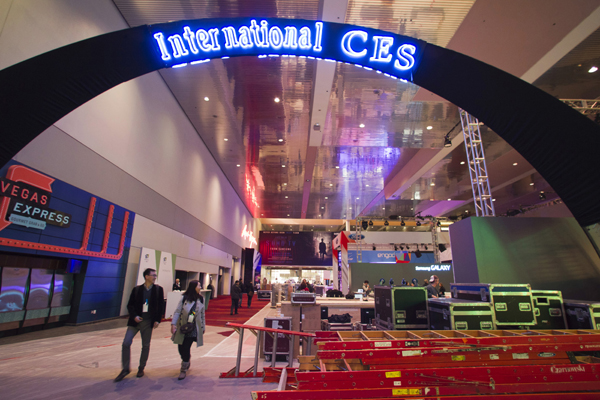 Workers set up booths in preparation for the 2015 International Consumer Electronics Show (CES) in the lobby of Las Vegas Convention Center in Las Vegas