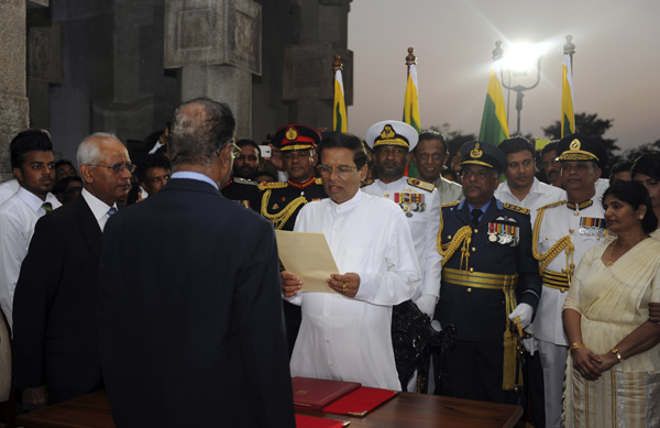 Sri Lanka's newly elected President Sirisena is sworn in during the country's sixth executive presidential swearing-in ceremony in Colombo