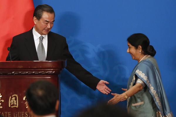 Chinese Foreign Minister Wang Yi with Indian Foreign Minister Sushma Swaraj at the 13th Russia-India-China Foreign Ministers' Meeting in Beijing. Source: Reuters