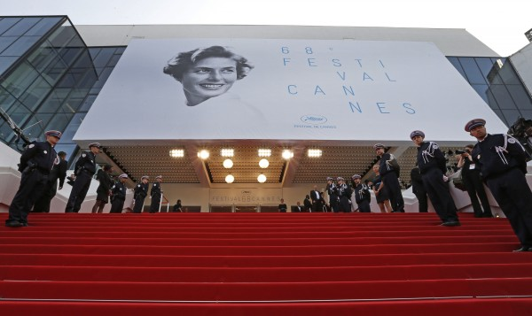 """French police officers stand at attention before arrivals on the red carpet for the opening ceremony and the screening of the film """"La tete haute"""" out of competition during the 68th Cannes Film Festival in Cannes"""