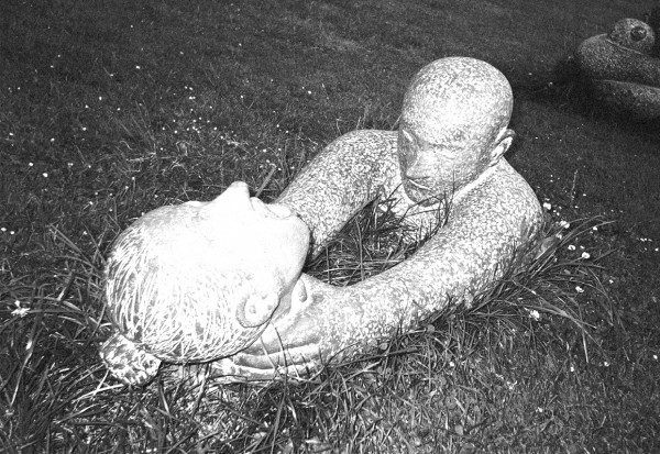 Image of strangling statues in Prague, taken by Flickr user David Sim, mixed by author. CC BY-2.0