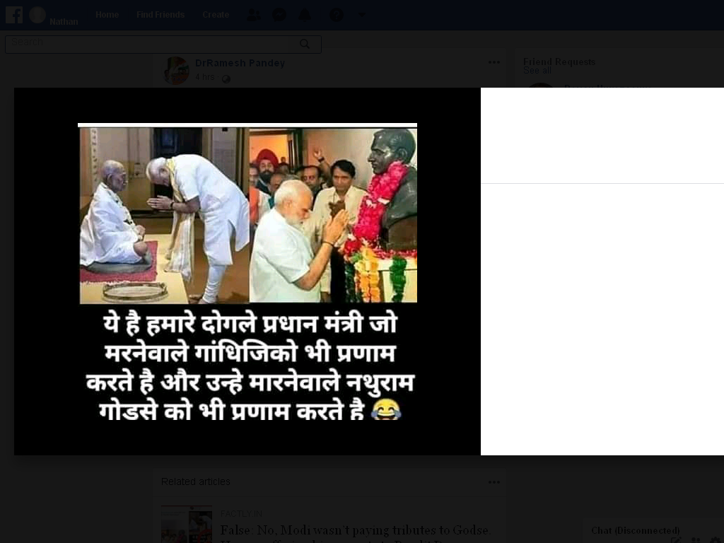 viral image of modi bowing to godse bust