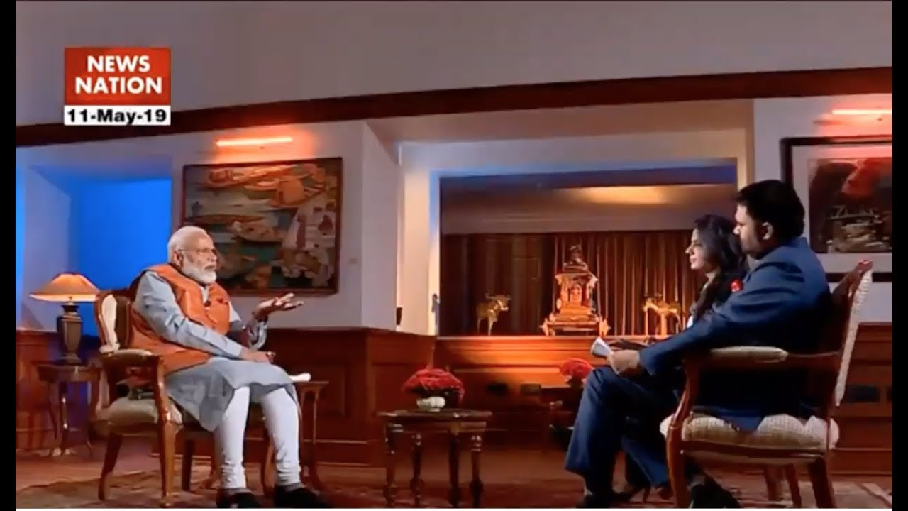 Image shows Modi standing in front of Matrix-like graphics