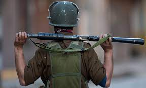 A soldier standing with a gun in Jammu and Kashmir